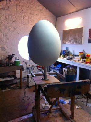 Giant egg getting ready for wax. Note the anticipatory excitement in the egg's posture.
