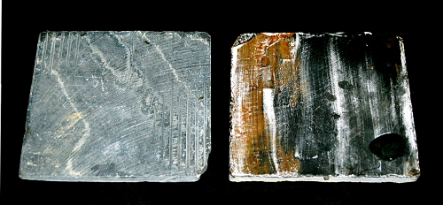 Slate tiles from Home Depot. The tile on the left is raw and unprepped. The one on the right has been heated and treated with three coats of cold wax. The white streaks are wax residue.