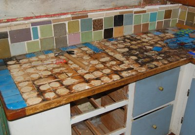 Here's the counter top with some of the blue tiles removed. By the way, we're saving the tiles for a future mosaic project.