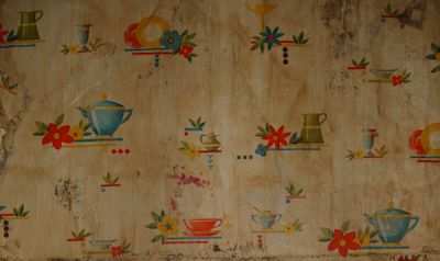 This wall paper had the bright colors of old Fiestaware. We guessed it was from the 30's or 40's. Water damage made it impossible to preserve any of it.