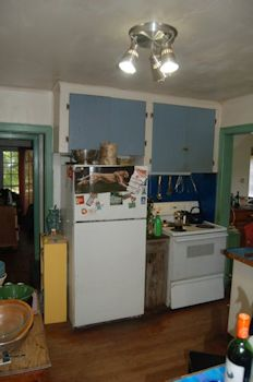 Before. Trapped between two doorways, the appliances were constant traffic stoppers. We saved the blue splash behind the stove. It's acrylic paint over stainless steel, made by my dad. Free to a good home, if you have a truck.