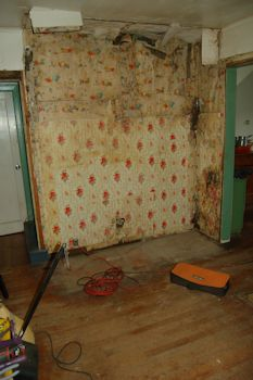 Stripped down to the wallpaper of previous owners.
